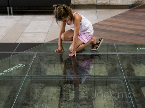 waterloo clearglassflooring girllookingthrough